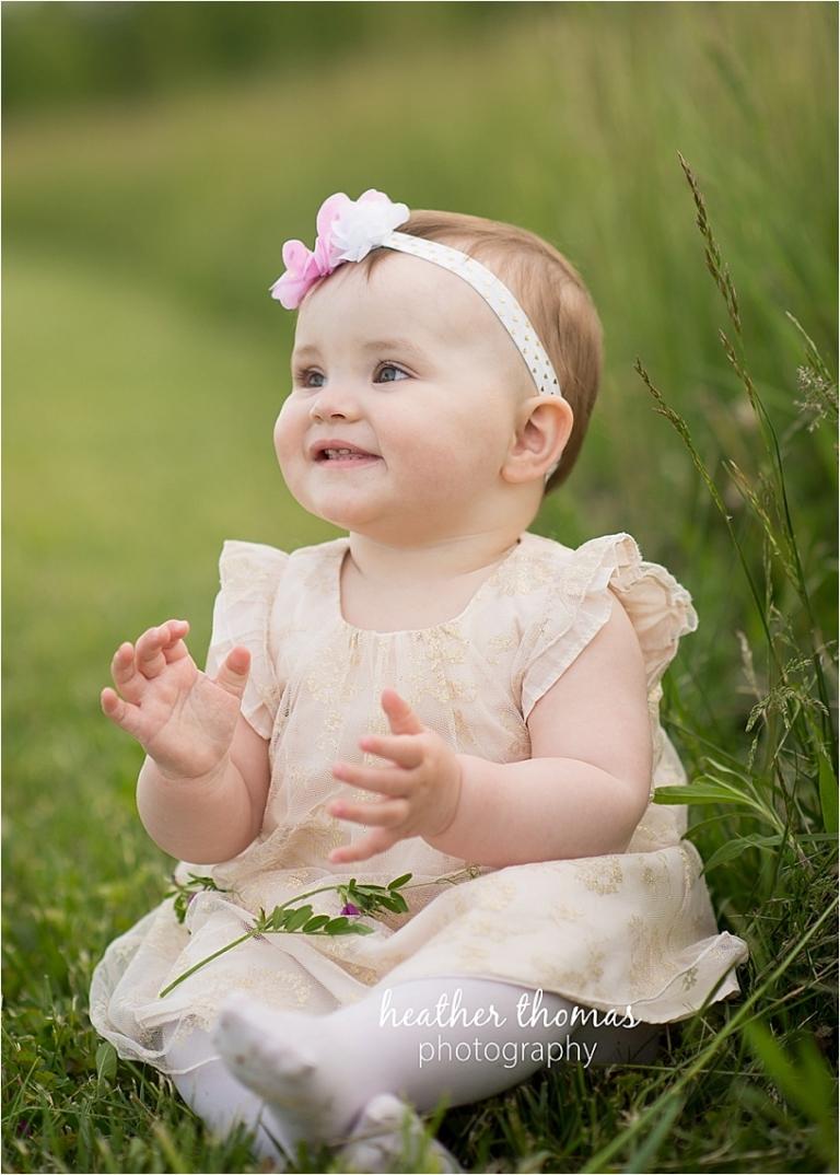 one year old baby in green field in philadelphia