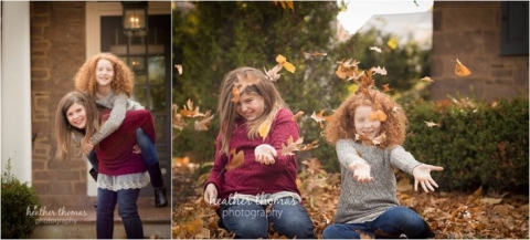 family in maroon and jeans outside in the fall throwing leaves