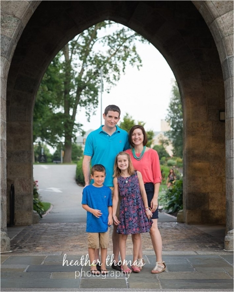 family standing underneath the cathedral arch at bryn athyn philadelphia