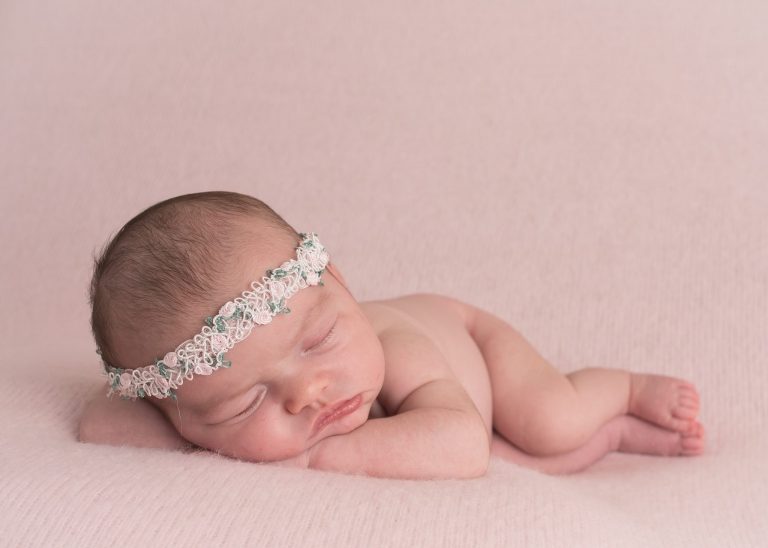 a photo of a newborn baby at a photo shoot