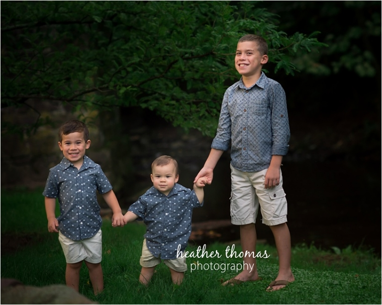 three boys dressed in blue outside at a park in newtown pa