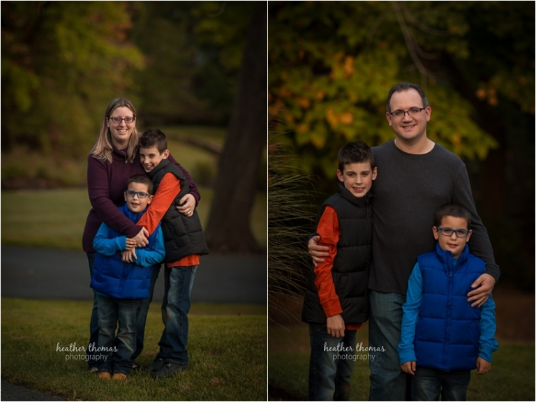 a photograph of two boys hugging their mom and dad outside with heather thomas photography