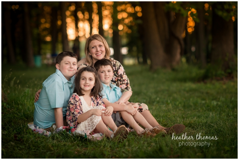 a photo of a mother hugging her three children at core creek park in langhorne pa