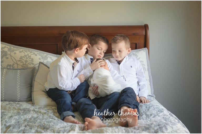 a picture of three boys and a newborn girl langhorne pa for a photo shoot with heather thomas photography