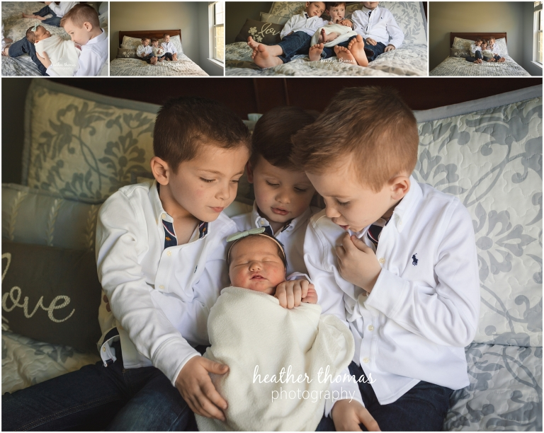 a picture of three boys holding a newborn girl in langhorne pa