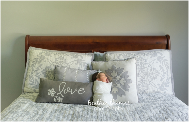 a picture of a newborn girl on a bed in newtown pa