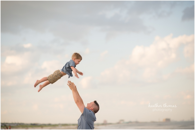 father and son portrait on the beach