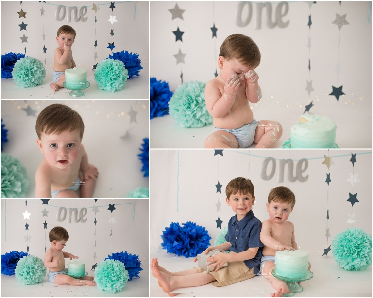 a picture of a one year old boy at a cake smash photo shoot
