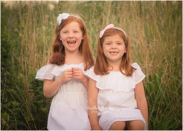 smiling sisters in a field in philadelphia
