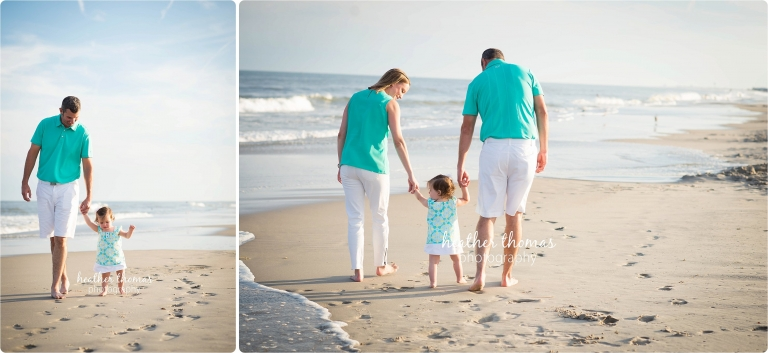 Parents and toddler walking on the beach