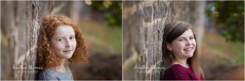 two girls leaning against a stone wall outside in bucks county pa