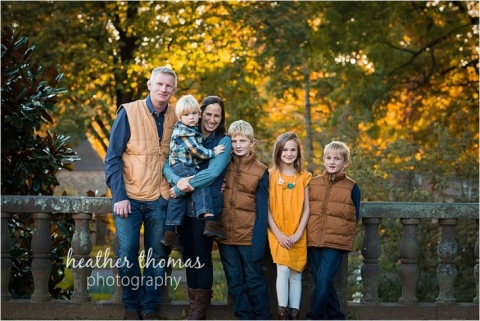 family of four dress in blue and yellow in philadelphia smiling for portrait