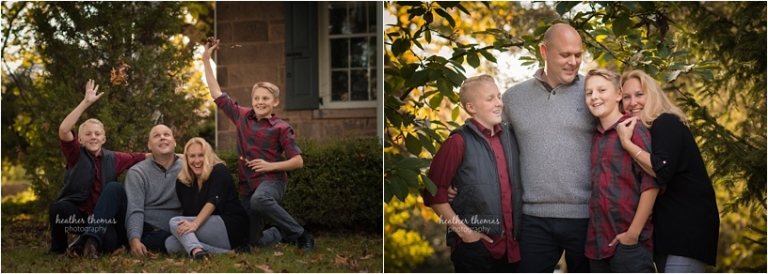 brothers wearing maroon and black with their parents outside for a fall photo shoot in newtown pa