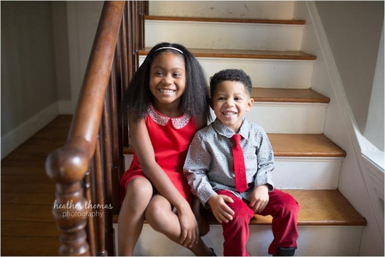 boy and girl smiling for photo shoot at christmas