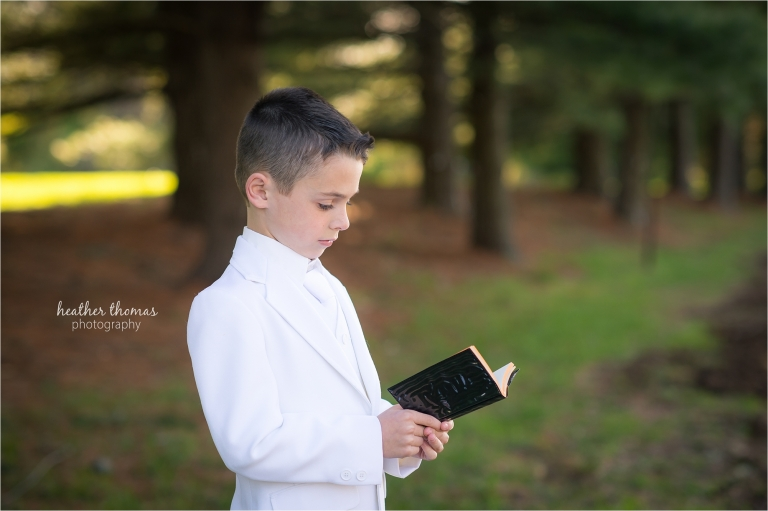 a 2nd grade boy reading his bible outside the catholic church in newtown pa