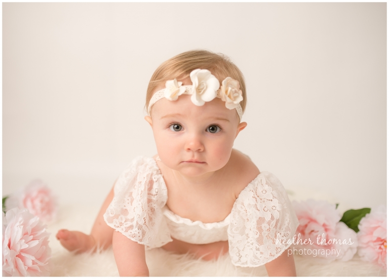 a closeup of a 9 month old infant in the photography studio with heather thomas photography