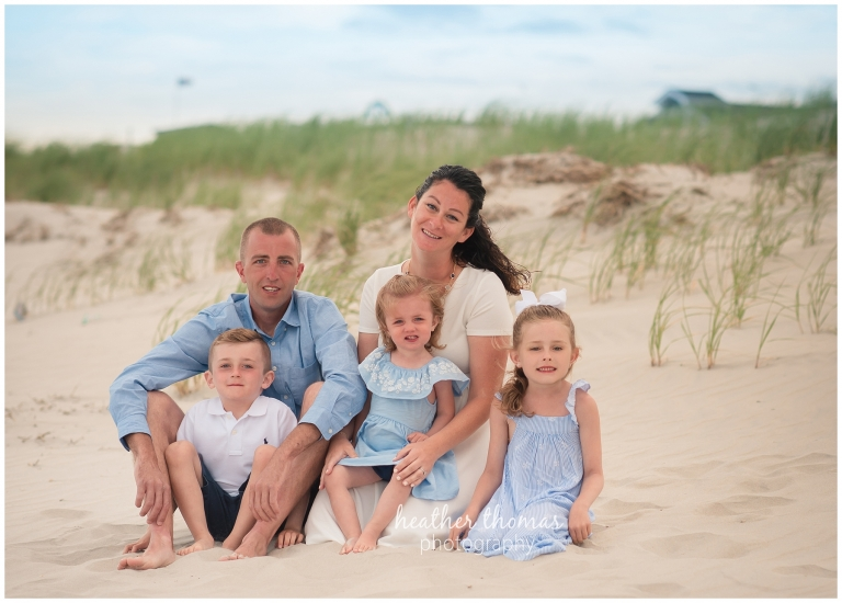 a family of 5 on the beach in sea isle city nj for beach portraits with heather thomas photography