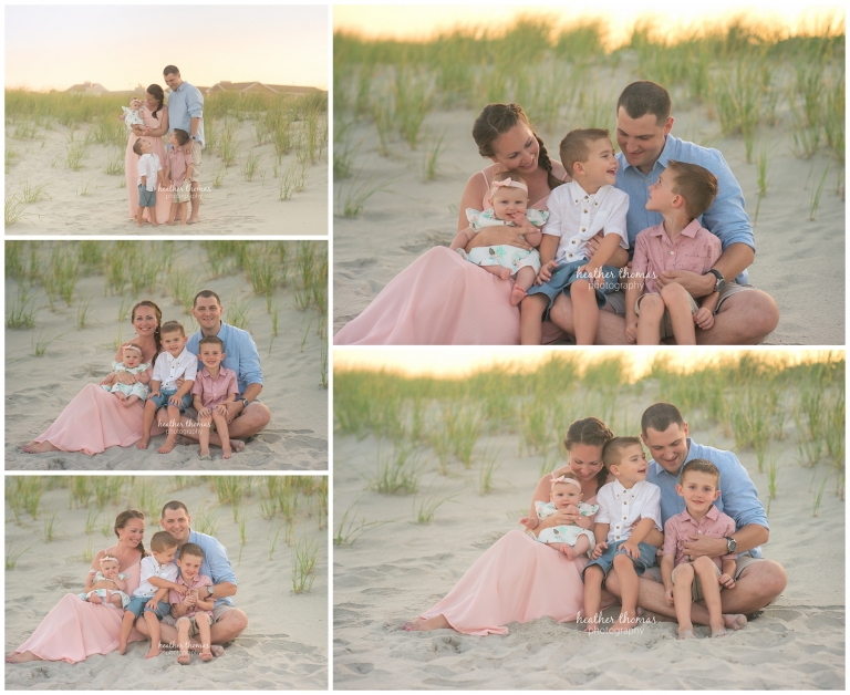 a family of 5 smiling wearing pink white and blue on the dunes in ocean city NJ