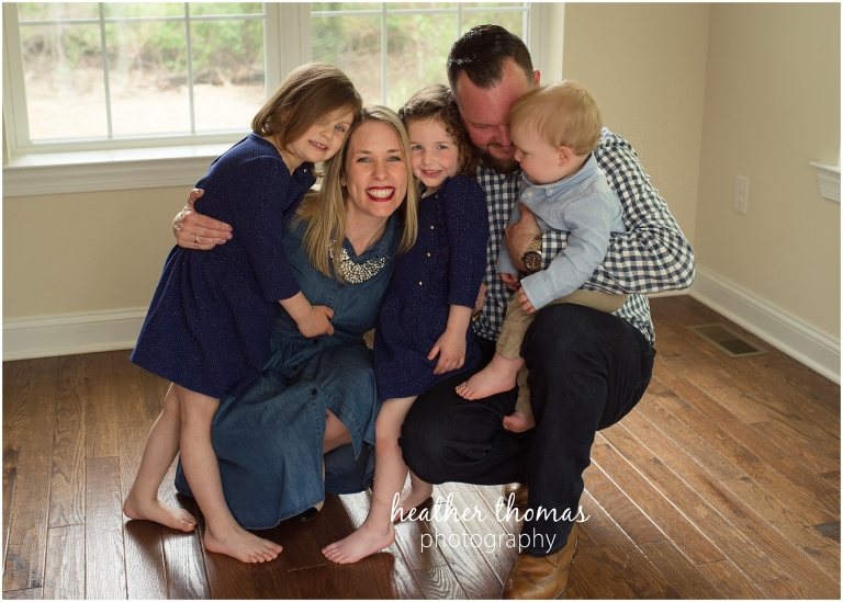 a family of five inside their home in lansdale squeezing for a photo shoot with heather thomas