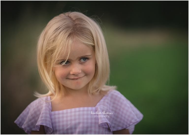 a portrait of girl in a field in philadelphia with heather thomas photography