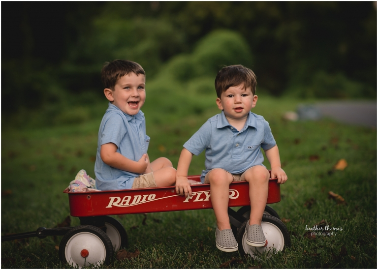 sibling portrait on red wagon
