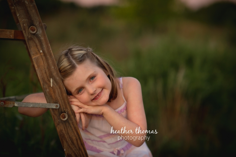 a picture of a girl outside at a field in Philadelphia with heather thomas photography