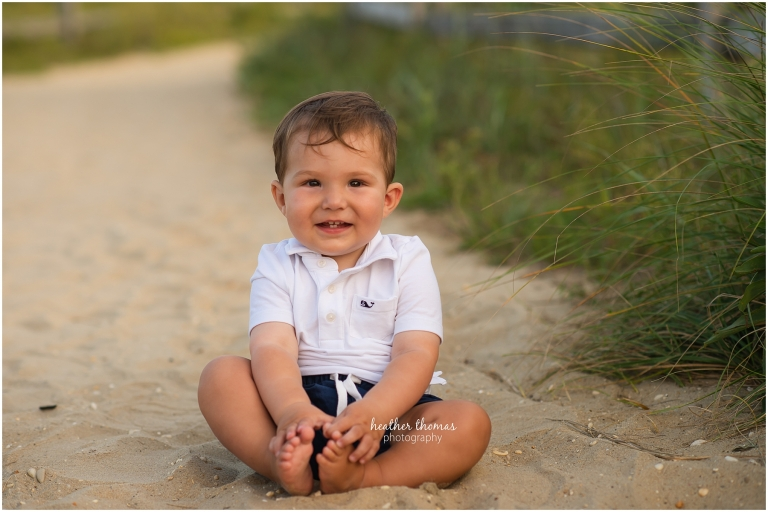 a 12 month old baby on the beach in ocean city for a photo shoot with Heather thomas photography
