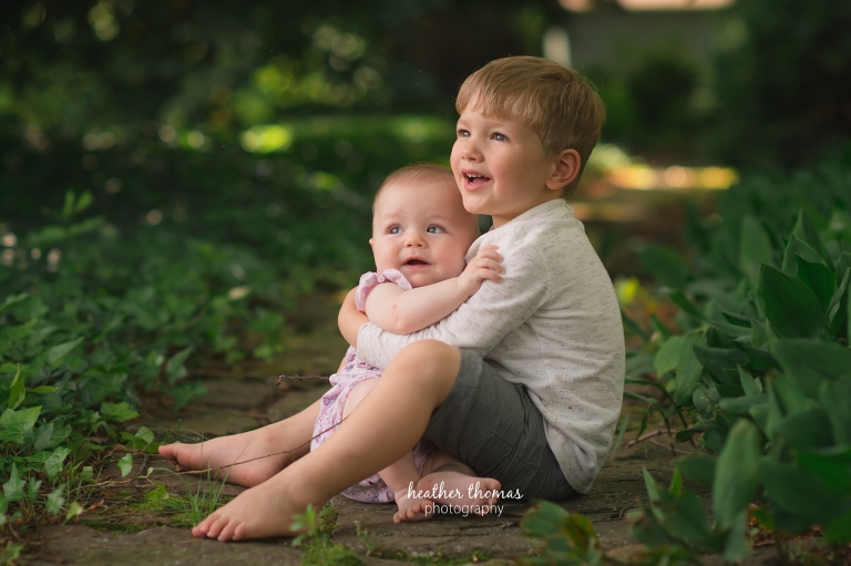 a brother and sister hugging outside for a photo shoot with Heather Thomas Photography in Philadelphia